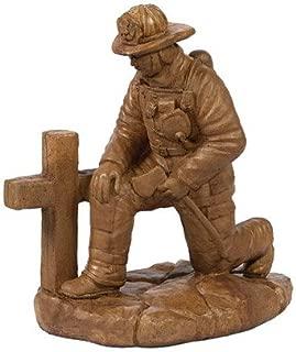 kneeling fireman statue