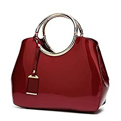 A red expensive looking cheap purse that is ultra catchy.