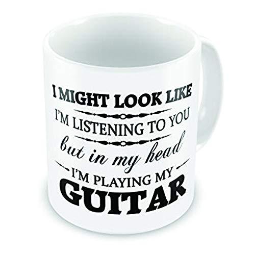 """Lustige Geschenktasse mit Aufschrift """"In My Head I'm Playing My Guitar""""."""