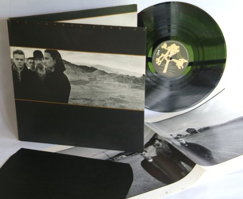 U2 the joshua tree. TOP COPY. First Uk pressing 1987 with poster/ lyric insert and black inner sleeve, on Island records
