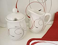 "Made of Porcelain Sugar Measures 5 1/2"" tall x 3 1/2"" dia Creamer Measures 4 1/2"" tall x 3 1/2"" dia Dishwasher Safe"
