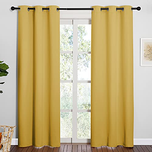 NICETOWN Energy Smart Thermal Insulated Solid Ring Top Blackout Curtains/Drapes for Bedroom (Yellow, 2 Pieces, 42 x 84 inch)