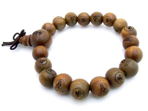 Agathe Creation – Pulsera rosario budista con perlas de madera de sándalo talladas – 11 mm de diámetro – Hecha a mano – Diseño de Buda – Color marrón verdoso