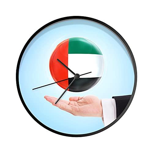 Uhr - Ø 30 cm - Schwarz - Flagge der Vereinigten Arabischen Emirate weht über Einer Hand - Wanduhr