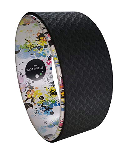 Artiststic paint splash + black yoga wheel for back bends stretching and balance.
