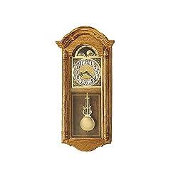 Howard Miller Fenston Golden Oak Wall Clock Golden Oak Dimensions: 13.5 W X 5 D X 28.5 H Weight: 15 Lbs