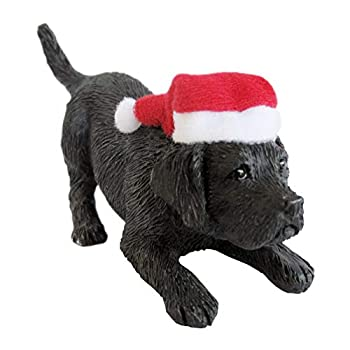 black lab puppy statue with Santa hat