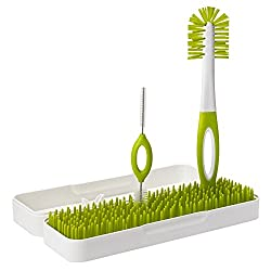 Boon Bottle Drying Rack - Two bottle brushes standing upright on a green grass drying rack with a white background