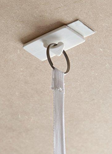 Gancho Adhesivo para la instalación de mosquiteras sin taladro. Incluye dos tiras adhesivas. Hasta 1,5 kg de peso.