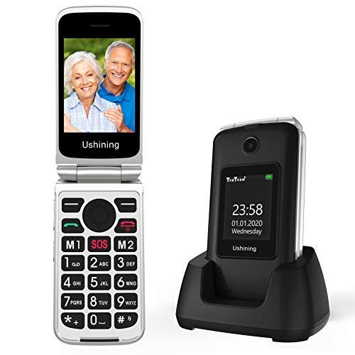 Ushining GSM Seniorenhandy Klapphandy ohne Vertrag, Großtasten Mobiltelefon Einfach mit Ladestation Notruftaste Dual-SIM Taschenlampe Kamera FM Radio 2,8 und 1,77 Zoll Farbdisplay - Schwarz