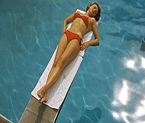 Posterazzi DAP18202 Gene Tierney - Laying on Diving Board in Orange Bikini Photo Print, 10 x 8, Multi