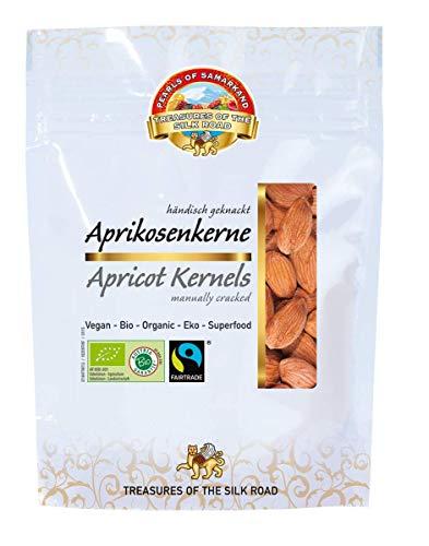 Semillas dulces de albaricoque orgánicas Fairtrade 700 g BIO, alimentos crudos, granos enteros pelados a mano de Samarcanda, garantizados sin cianuro, sin ácido hidrocianico, de Uzbekistán 7x100g