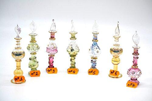 7 Esencieros perfumeros de cristal grupo 6/15 cm.