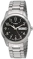 Silver-tone 18mm stainless steel expansion band fits up to 8-inch wrist circumference Black dial with day & date window at 3 o'clock; full Arabic numerals Silver-tone 36mm brass case with mineral glass crystal Indiglo light-up watch dial Water resist...
