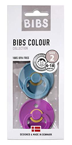 """Ciuccio """"Colour"""", prodotto del marchio danese Bibs, in gomma naturale, a forma di ciliegia, in confezione da 2 pezzi, misura 2 (6-18 mesi), colori: verde petrolio/lilla."""