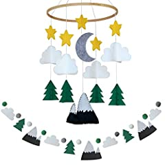 Bring the outdoors inside with this serene mountain and woodland themed mobile! Evergreen trees, clouds, stars and a moon with a snow capped mountain come together to make this woodland dream complete! Babies Perspective: This felt and wood mobile is...