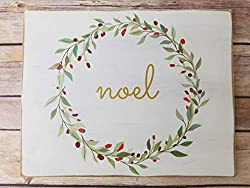 Farmhouse Christmas Decor sign with noel and garland around it.