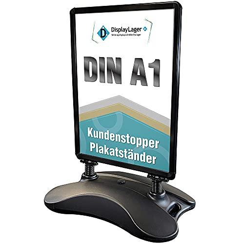 Kundenstopper Plakatständer Wind-Sign - Schwarz | Postermass DIN A1 594x841 mm. Robuster Wetterfester Plakataufsteller | Standgewicht für hohe Windgeschwindigkeit | Rollen für einfache Transport