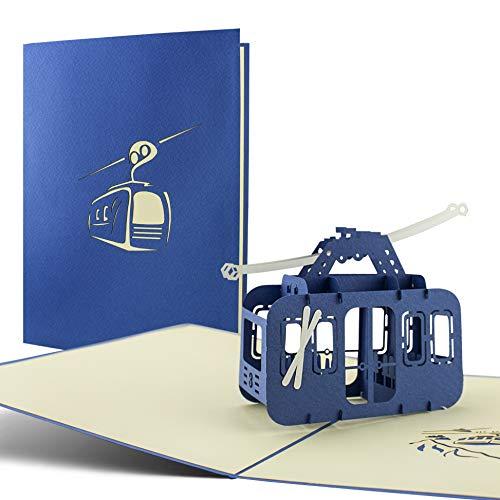 Carte postale pop up en 3D thème sports d'hiver et sports de montagne: idéal pour offrir un bon cadeau aux amateurs de ski, snowboard et randonnée en montagne. Parfait comme carte d'anniversaire.
