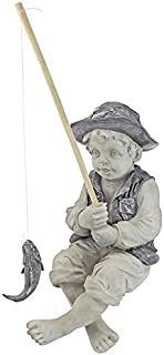 garden statue of little boy fishing