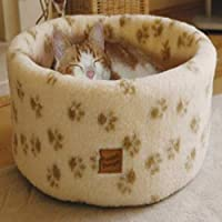 Our Cat Cosy is the ultimate in feline luxury. Featuring a delicate paw print on rich cream fleece. A deep inner cushion and high walls. A warm and snug place for any cat to escape from the world. The Cat Cosy is available in two sizes.