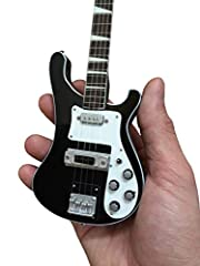 Miniature Guitar Collectible - Perfect Gift for Guitar Player Handcrafted from solid wood, polished & airbrushed with great detail Includes a high quality adjustable mini guitar stand AXE HEAVEN Mini guitar gift box is included Detailed all metal tun...