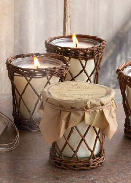 Farmhouse style candles in wicker candle holders.