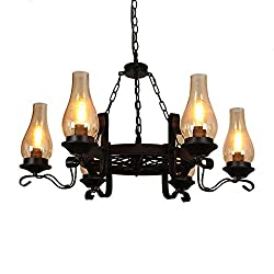A wagon wheel chandelier with metal and chimney glass
