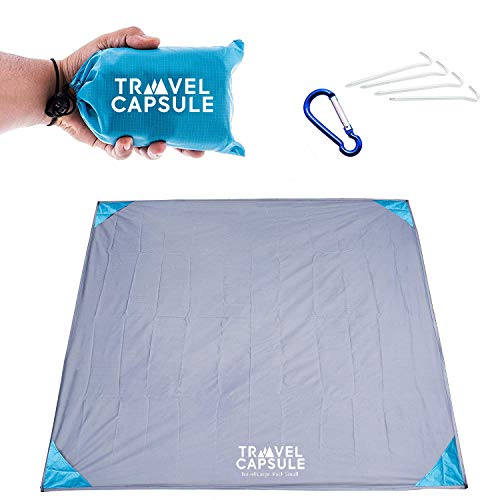 416T4RCM31L - Travel Capsule Large Outdoor Pocket Blanket 55″x70″ - Perfect for Hiking, Camping, Outdoor Sporting Events, picnics and More! Stakes and Carabiner Included. Perfect for Quarantine HANGOUTS!