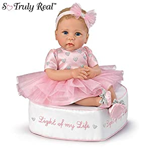 This lifelike baby doll is handcrafted with soft RealTouch vinyl skin, hand-rooted hair, handpainted lips and fingernails, hand blushed cheeks and limbs, and delicate hand-placed eyelashes Her little body is weighted and poseable to feel so lifelike ...