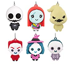 """Which character from """"The Nightmare Before Christmas"""" will you get? Blind bag includes 1 ornament packaged at random so it's a mystery until opened: Jack, Sally, Oogie Boogie, Lock, Shock or Barrel. Made of plastic, each Hallmark Ornament measures ap..."""