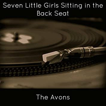Seven Little Girls Sitting in the Back Seat