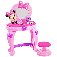 Get ready for the big Party with the Minnie happy helpers bowdazzling vanity! This charming set has a large mirror featuring a magical twinkling bow with lights that plays Minnie Mouse phrases. The set also comes with a matching stool, play brush, pl...