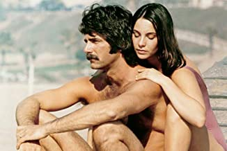 Sam Elliott and Kathleen Quinlan in Lifeguard bare chested on beach 11x17 Mini Poster