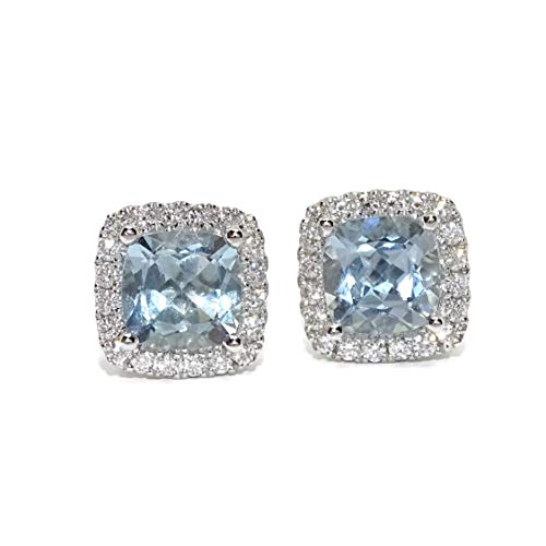 Orecchini in oro bianco da 18 k con diamanti da 0,41 ct e 2,53 ct di acqua marina. Dimensioni 1 x 1 cm, chiusura a pressione.