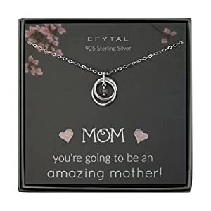 The Meaning: Celebrate the mom-to-be in your life and remind her about the everlasting bond she will soon share with her new baby. This beautiful necklace of 2 interlocking rings and a sparkly gem represents that precious little one growing inside. W...