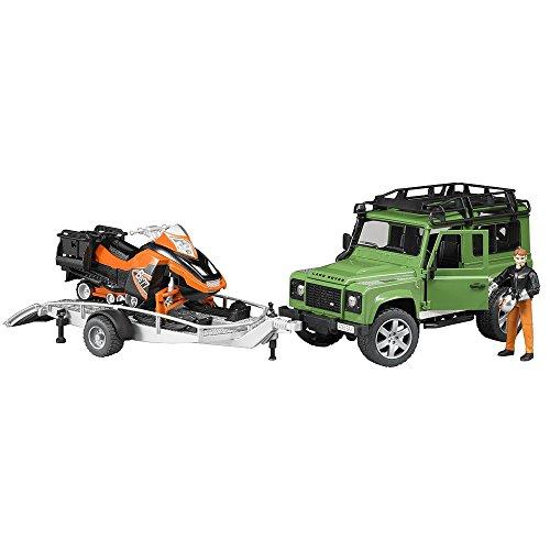 Bruder 02594 TOYS Land Rover Defender Station Wagon mit Anhänger, Snowmobil mit Fahrer und Zubehör