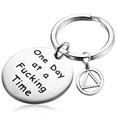 Sobriety Gift - One day at a fucking time. An high quality gift for the special person who is on the road to recovery, has reached a meaningful milestone or is celebrating a sobriety anniversary. Encouraging words to live by...One day at a time. Mate...