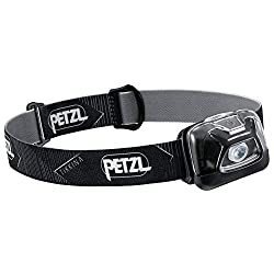 A black Petzel brand headlamp used by campers and outdoor enthusiasts.
