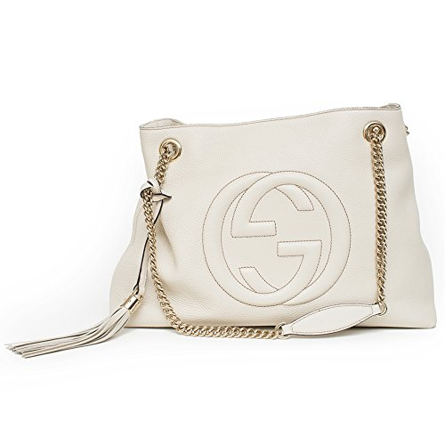 A medium size Soho shoulder bag with double chain shoulder straps and an embossed interlocking G. Made in our light, natural grain leather in Ivory White. Light gold toned hardware Ivory Ivoire Off-white leather Detachable leather tassel Embossed int...