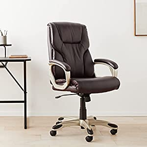 Comfortable executive chair upholstered in brown polyurethane bonded leather with a satin gold metal finish Padded seat, back and arms for all-day comfort and support; perfect for home office, computer desk or executive conference room Pneumatic seat...