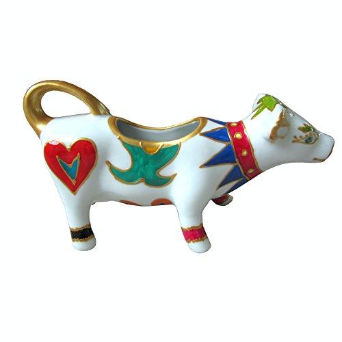 Lattiera in porcellana a forma di mucca, dipinta a mano, disegno originale 'Bondi'. Lussuoso cofanetto regalo rosa e nero.
