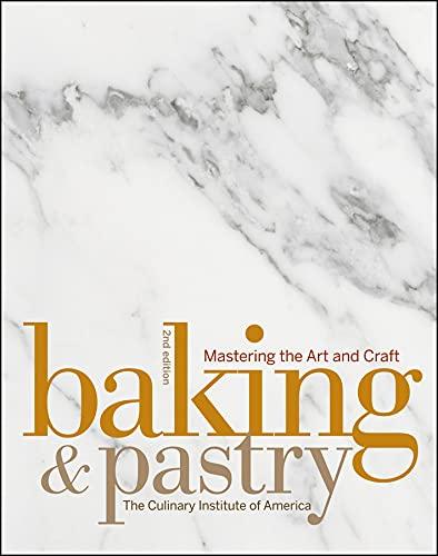 The kinfolk table book beside baked pastry on white ceramic plate.
