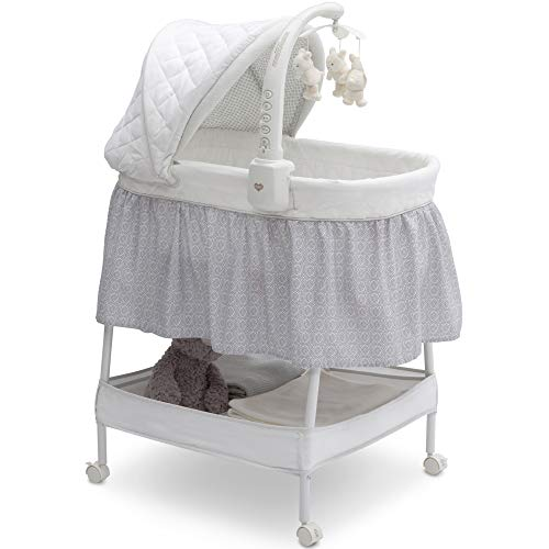 Delta Children Smooth Glide Bedside Bassinet  Portable Crib with Activity Mobile Arm Featuring Spinning Toys Nightlight and Music Silver Linings