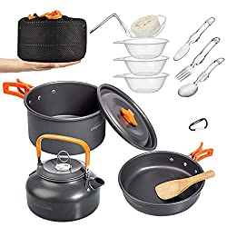 A compact set of various cookware items such as pots, pans and utensils suitable for a camping trip.