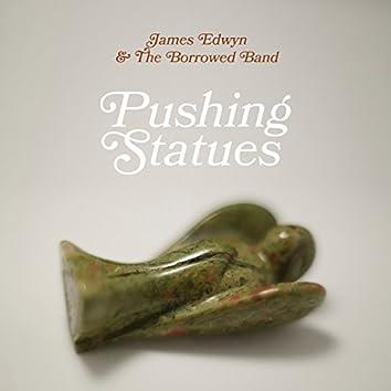 Pushing Statues