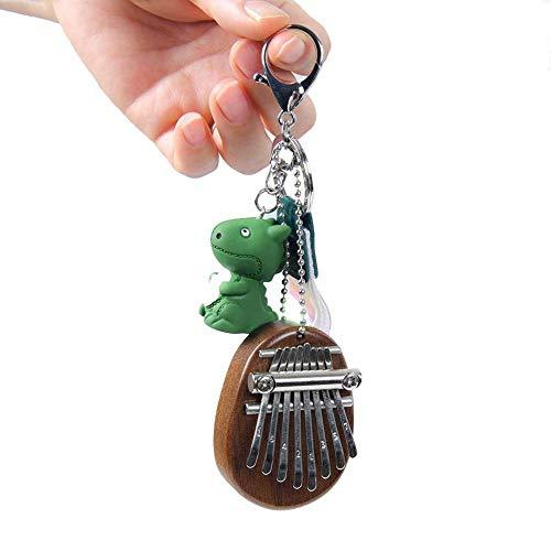 Kalimba Daumenklavier , Mini Kalimba 8-Tasten Tragbar Daumen Klavier Solid Finger Klavier mit 1 x Kleiner Dinosaurieranhänger , 1 x Farbiges kugelförmiges Ei, 1 x Lanyard (Weihnachts-Sonderausgabe)