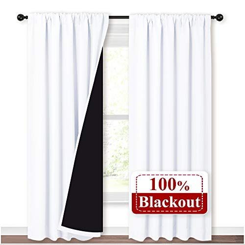 NICETOWN 100% Blackout Curtain Panels, Rod Pocket Window Curtains with Black Liner for Nursery, 84 inches Drop Heat and Full Light Blocking Draperies (White, 2 Pieces, 52 inches Wide Each Panel)