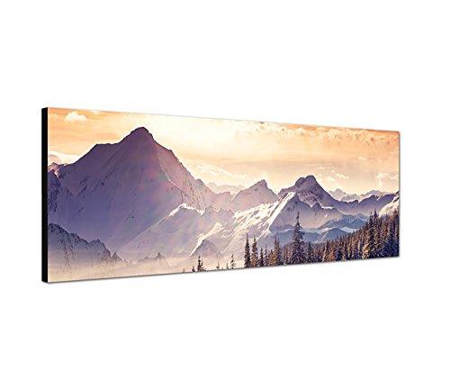 Wandbild auf Leinwand als Panorama in 150x50cm Berge Wald Schnee Wolken Sonnenstrahlen