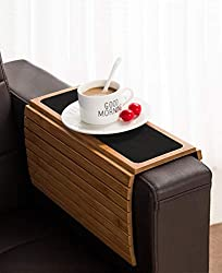 The Bamboo Sofa Arm Tray Table sets on the couch arm to act as a table.